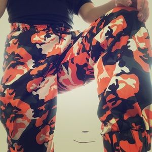 Green and orange camo joggers